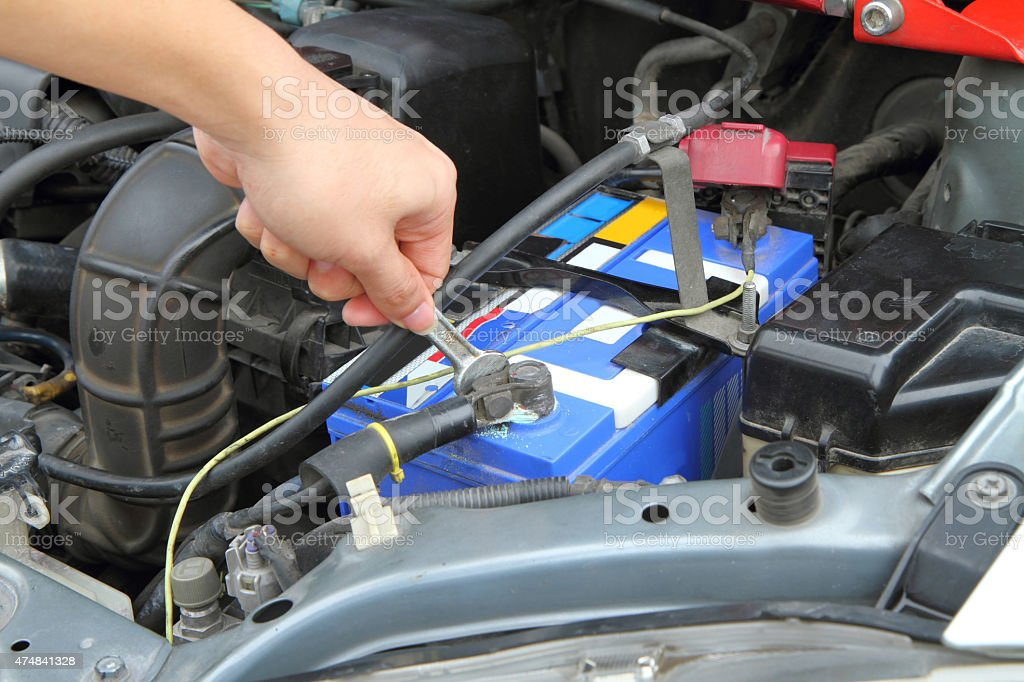 Change car batteries. stock photo