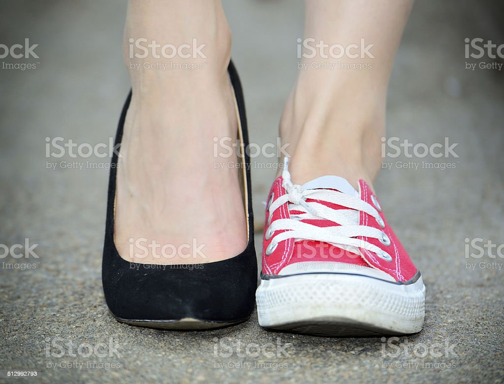Change of woman shoes, contrast stock photo