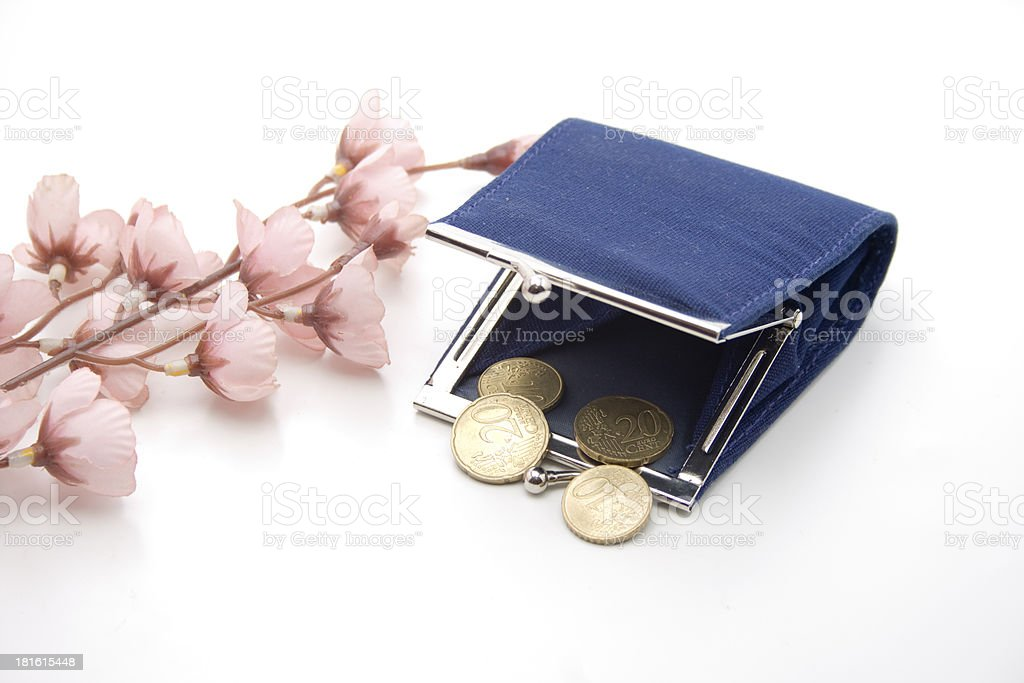 Change purse with money and blossoms royalty-free stock photo