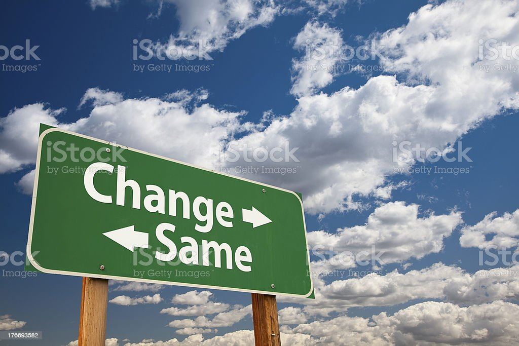 Change, Same Green Road Sign Over Clouds stock photo