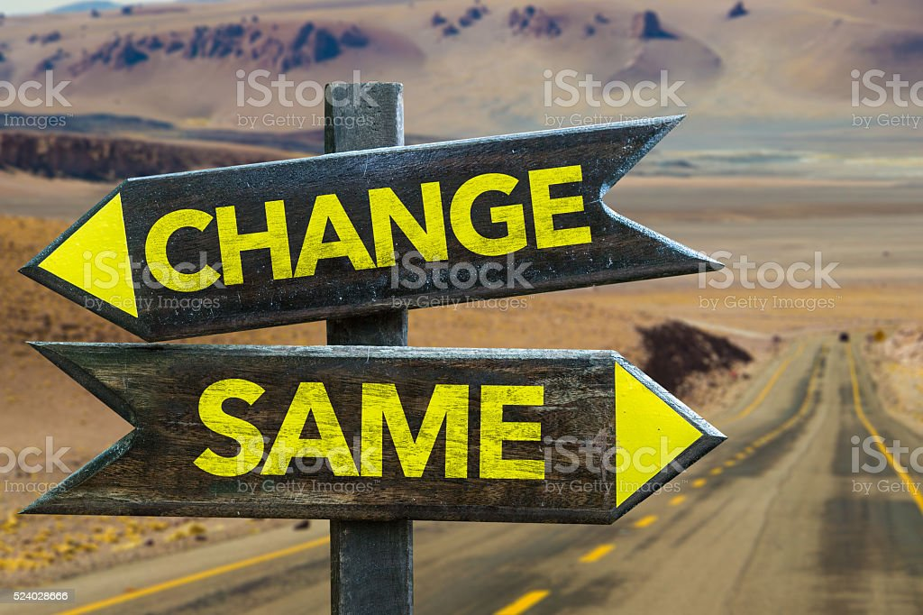 Change - Same signpost in a desert road on background stock photo