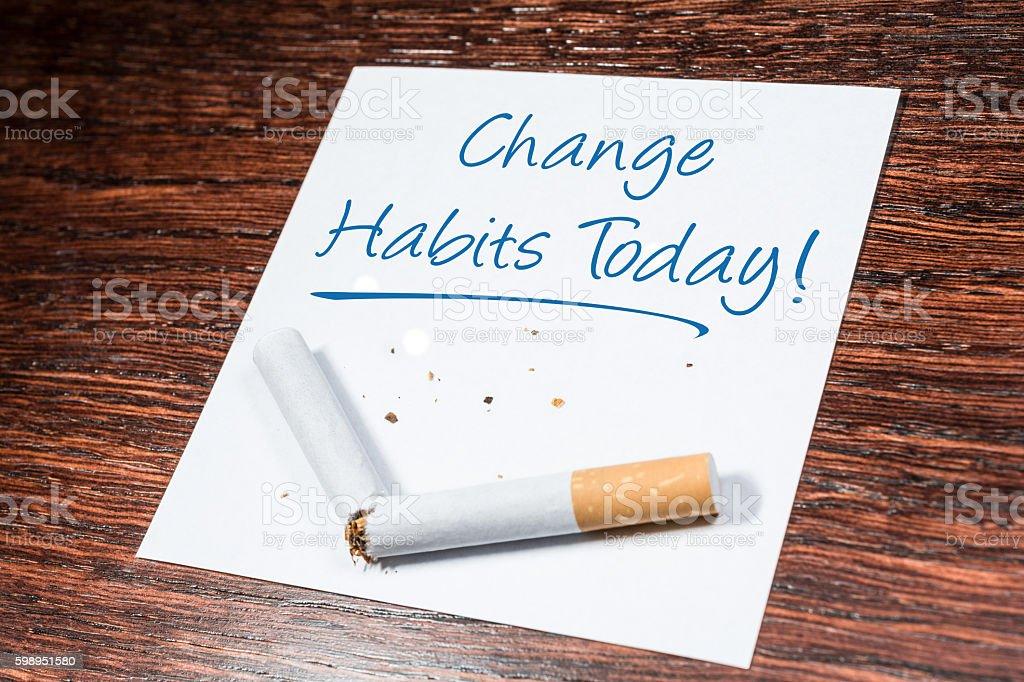 Change Smoking Habit Reminder With Broken Cigarette On Wooden Shelf stock photo