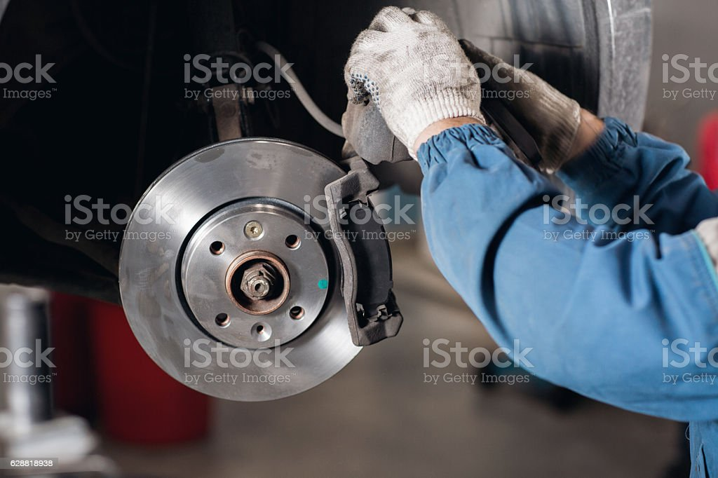 change the old drive to the Brand new brake disc stock photo