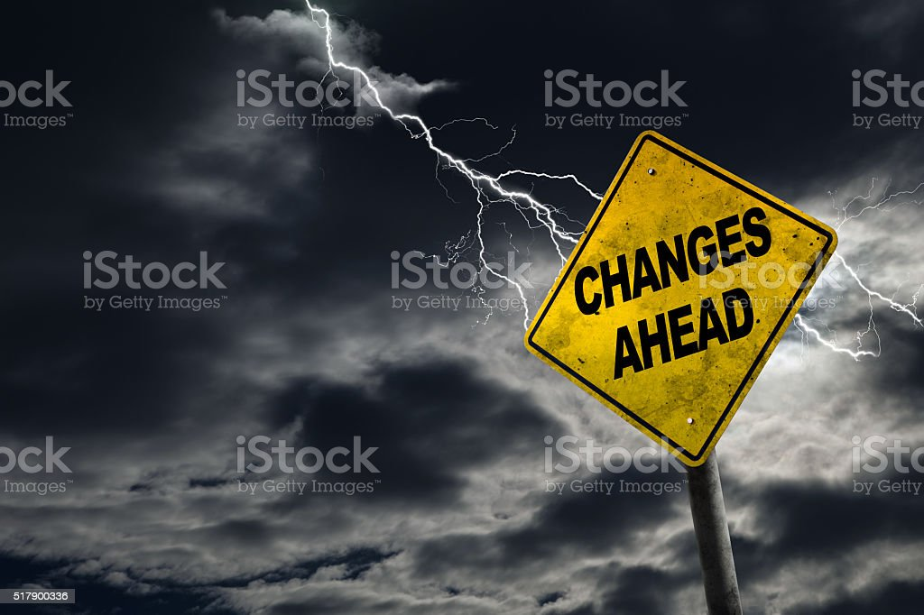 Changes Ahead Warning Sign in Thunderous Background stock photo