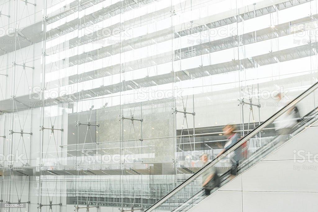 Changi Airport escalator with travelers stock photo