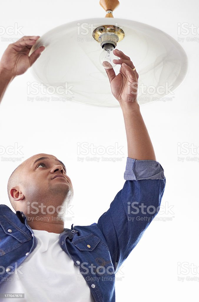 Changing a lightbulb stock photo