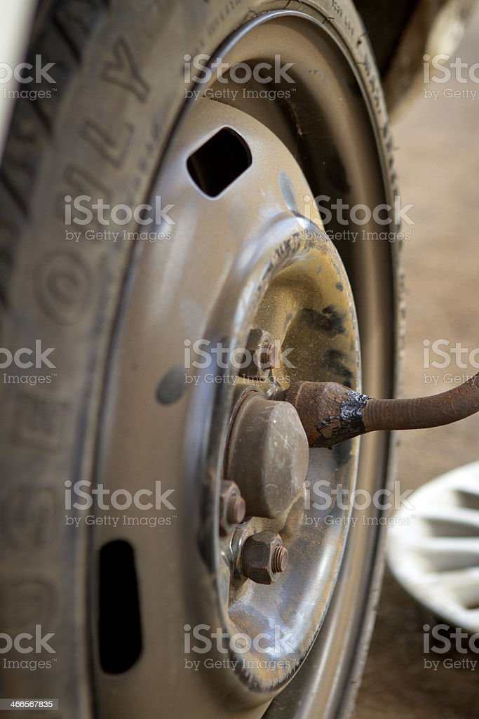 Changing a wheel on old car. stock photo
