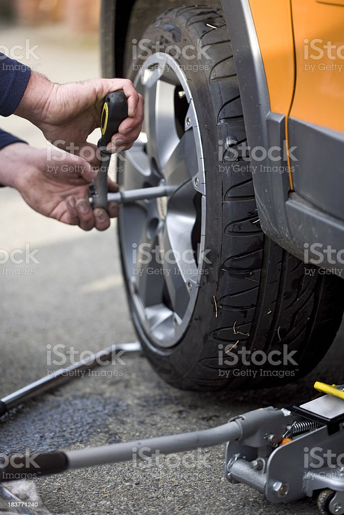 Changing a wheel stock photo