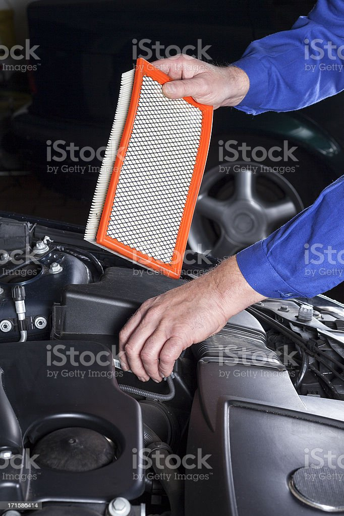 Changing an engine air cleaner/filter royalty-free stock photo