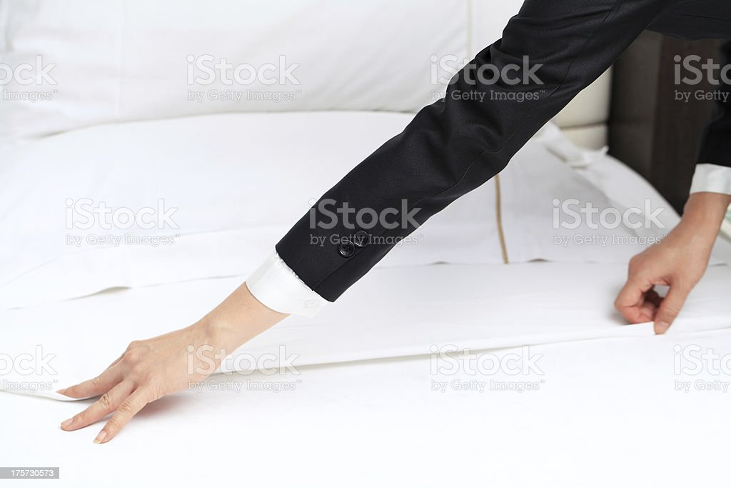 Changing Bed Sheets stock photo