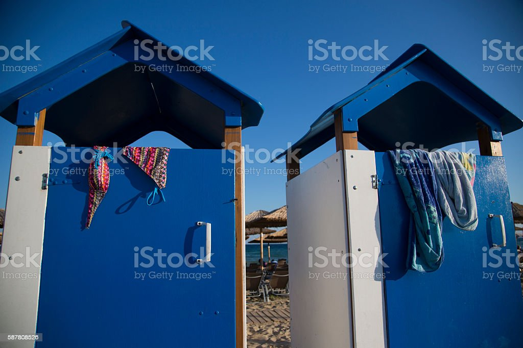 changing cabins on the beach stock photo