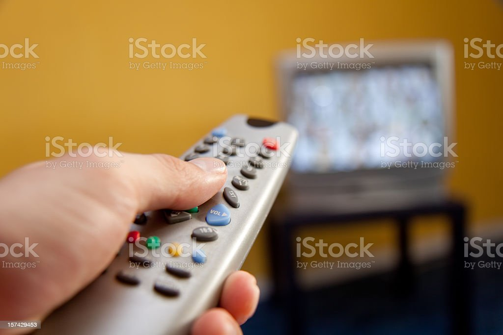 Changing channels with a to remote stock photo
