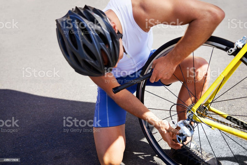 Changing his bike tyre stock photo