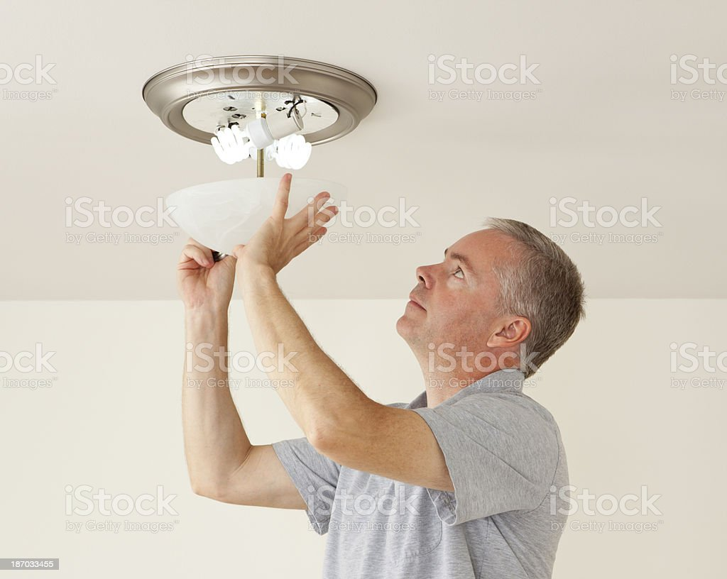 Changing Light Bulbs stock photo
