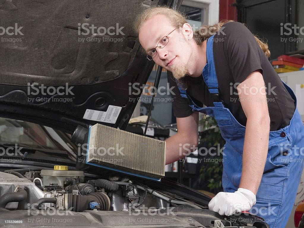 Changing the air filter stock photo