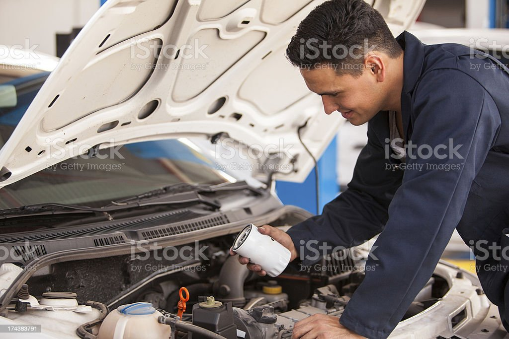 Changing the oil filter in an auto shop stock photo