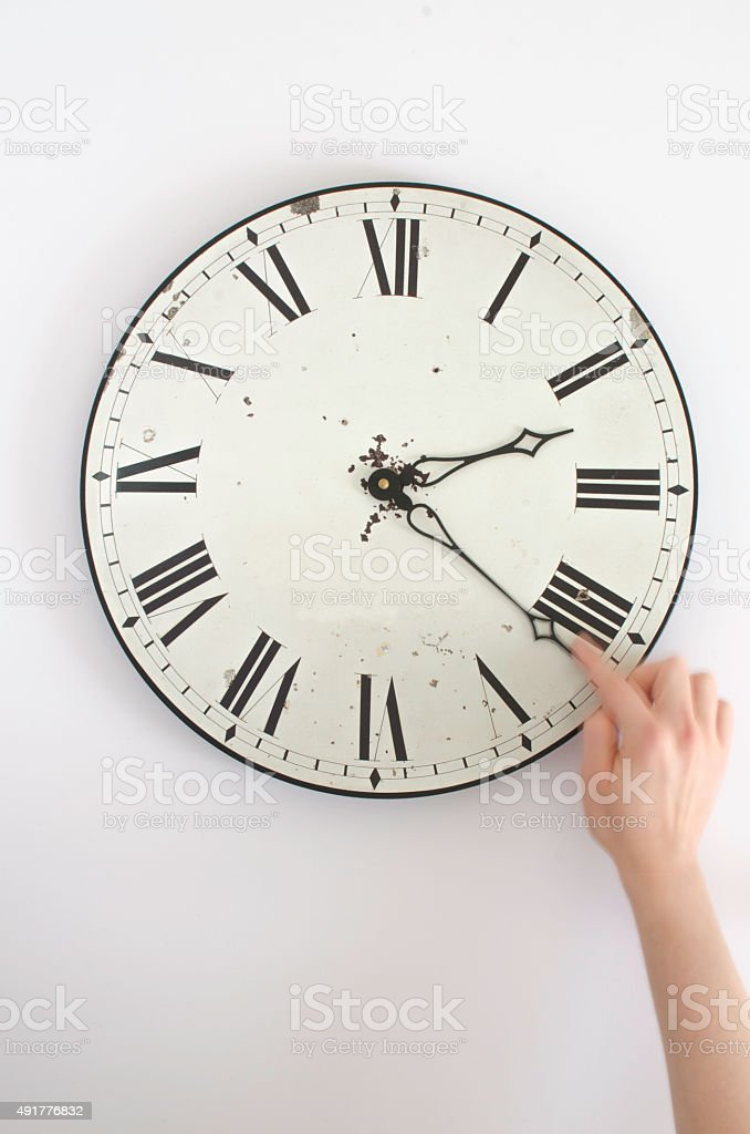 Changing the time at the clock stock photo