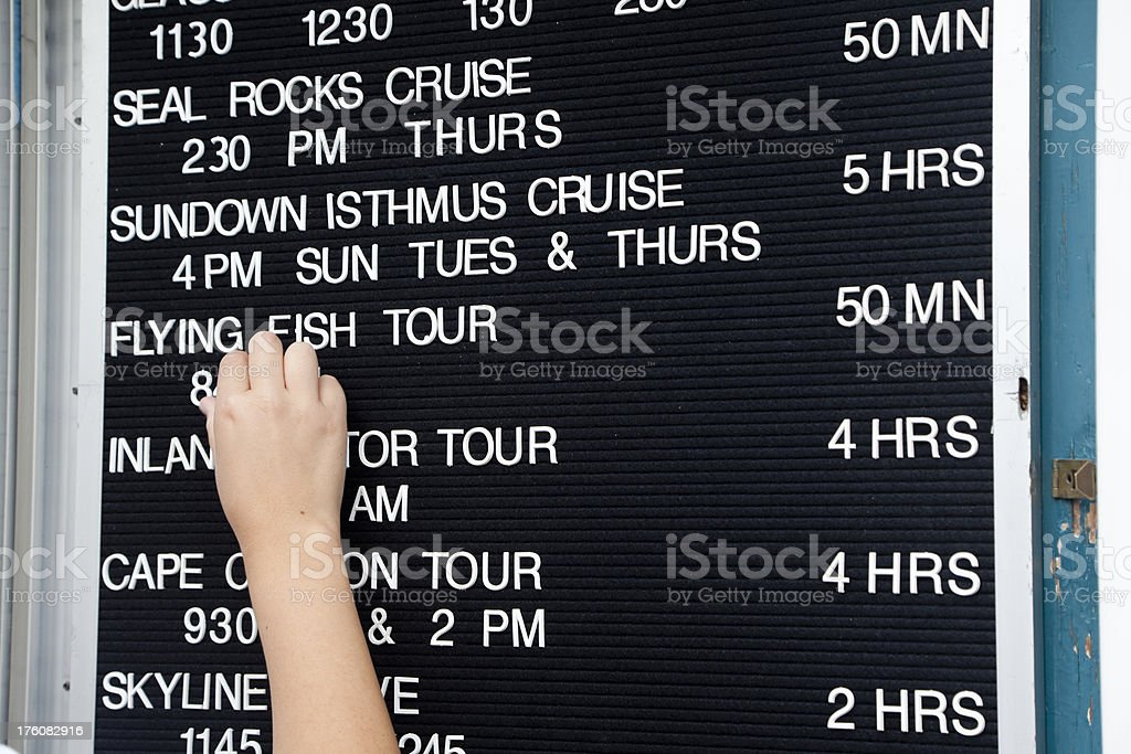 Changing the Tour Times on Reader Board stock photo