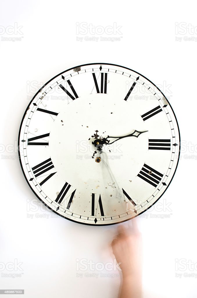 Changing the wall clock stock photo