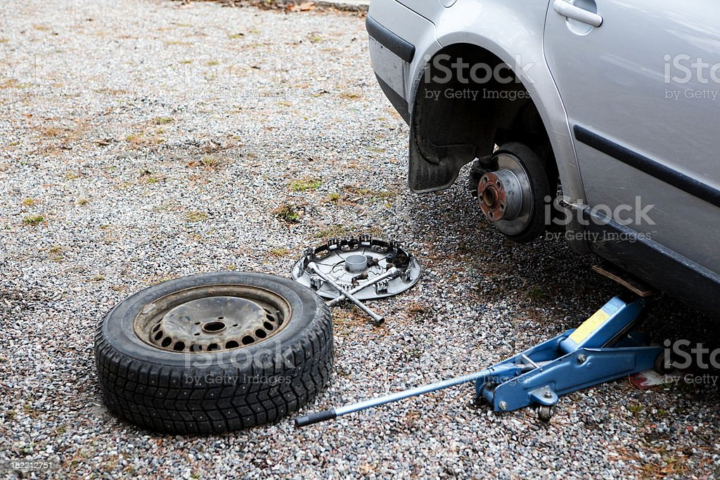 Changing tire royalty-free stock photo