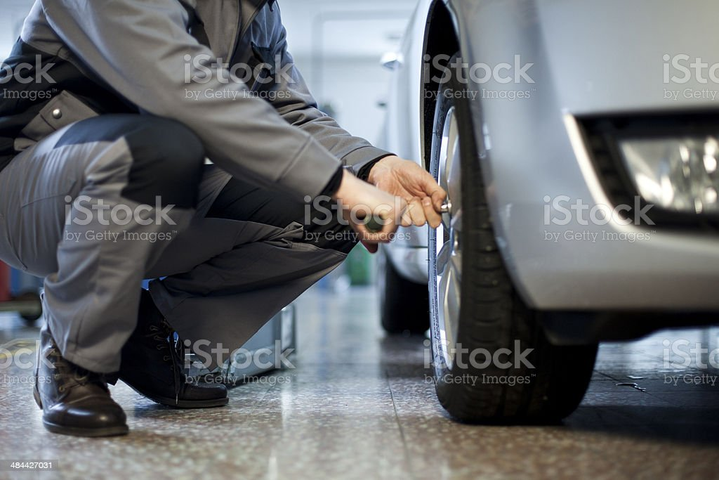 Changing tires stock photo