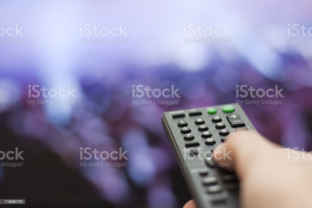Changing TV Channel royalty-free stock photo