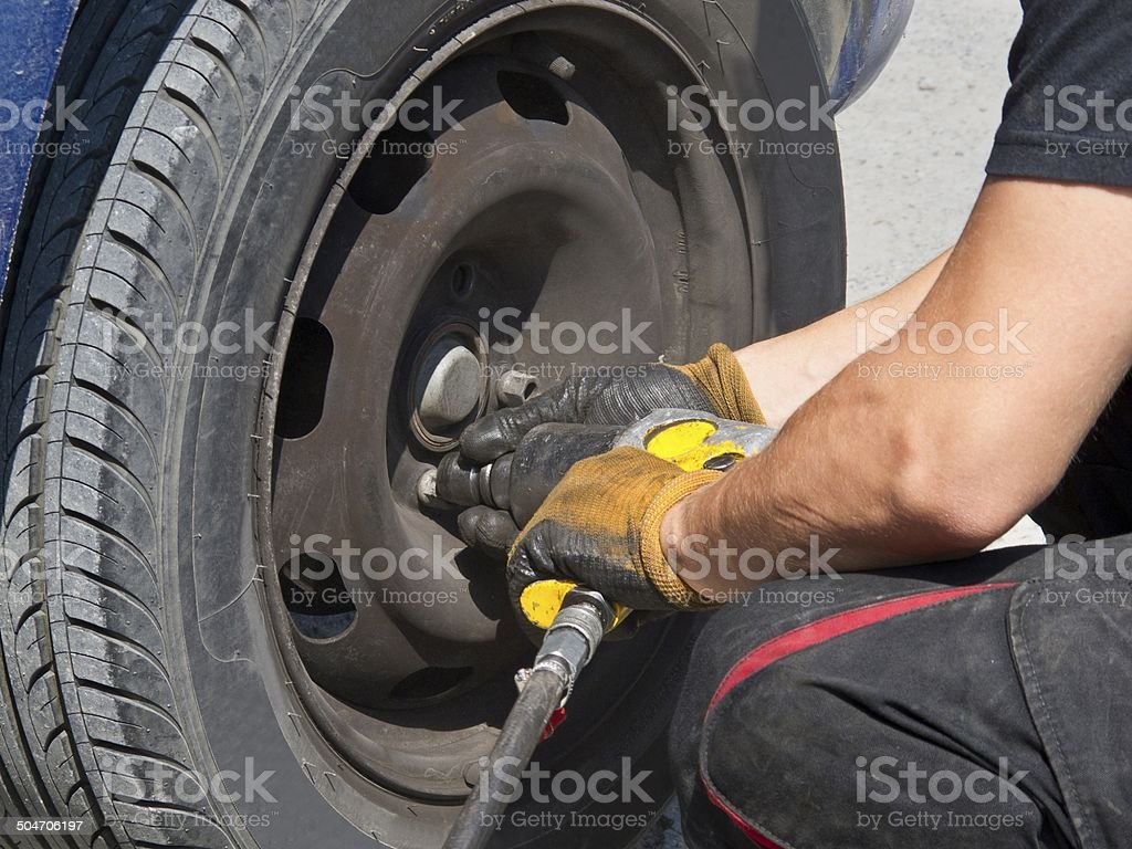 Changing tyre stock photo