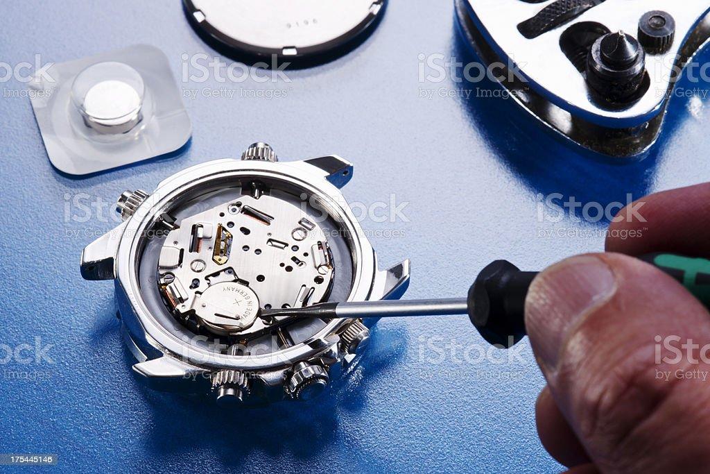 Changing watch battery stock photo