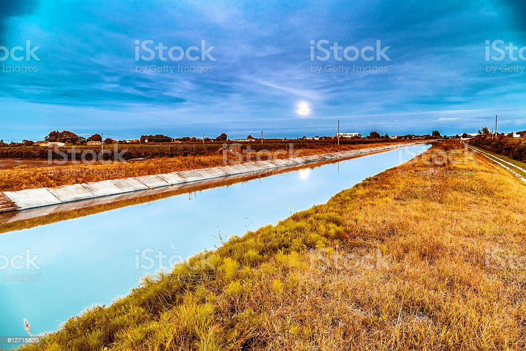 Channel for irrigation of cultivated fields stock photo