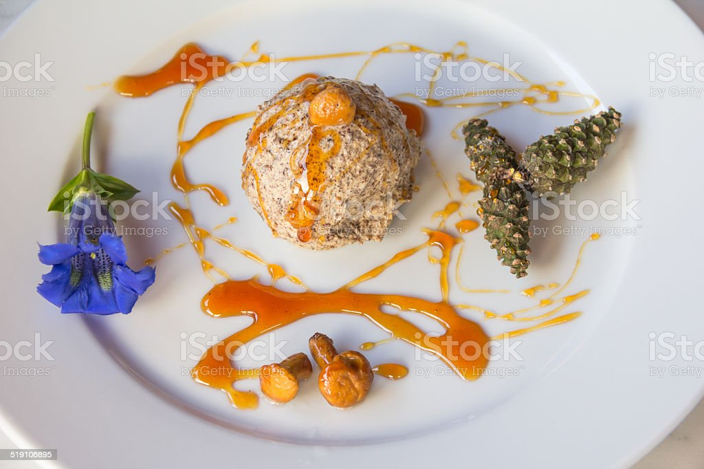 Chanterelle Parfait With Swiss Pine Caramel And Gentian stock photo