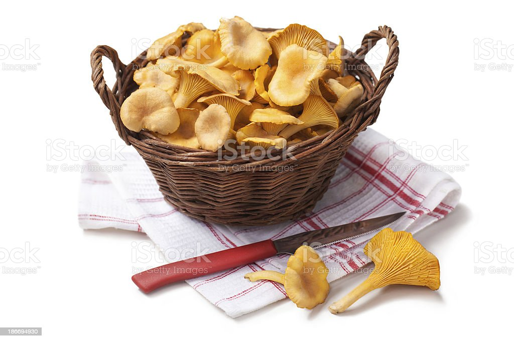Chanterelles in a basket royalty-free stock photo