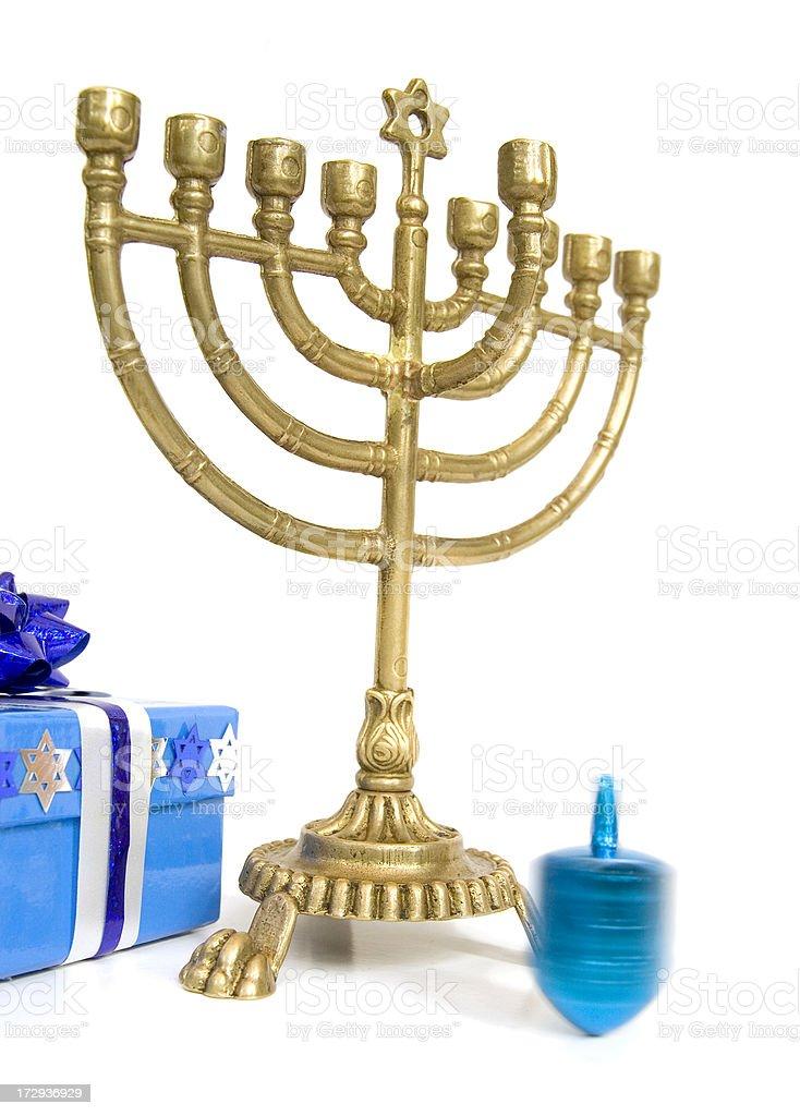 Chanukah menorah, gift and spinning dreidl royalty-free stock photo