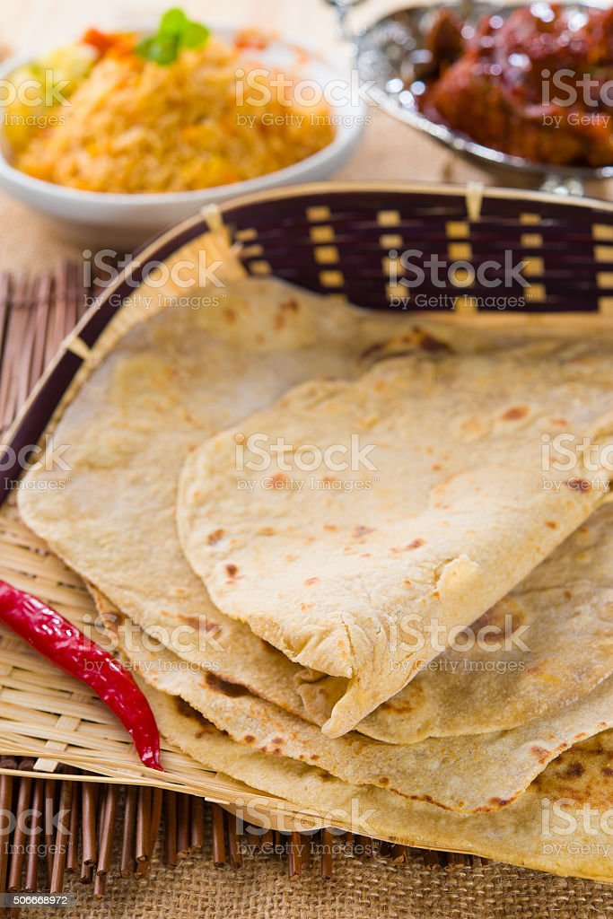 chapathi with various indian foods in traditional lifestyle stock photo