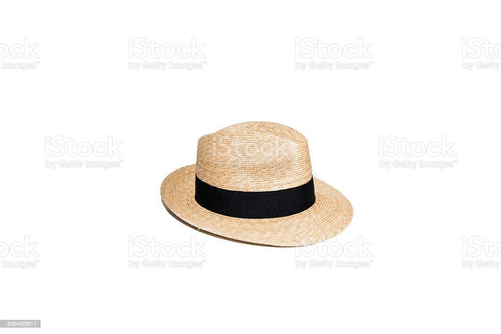 Chapeau de paille avec un ruban noir . stock photo