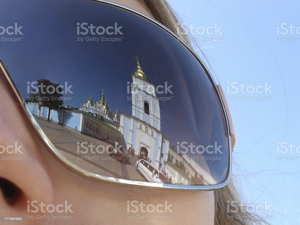Chapel building reflected in a woman's sunglasses lens stock photo