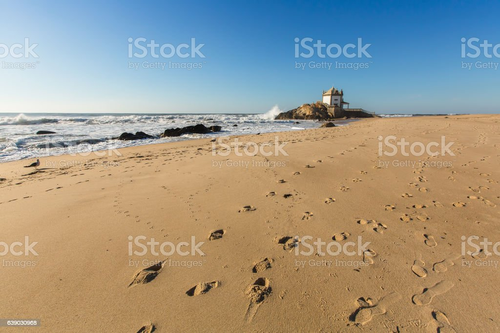Chapel Senhor da Pedra on Miramar Beach (Praia de Miramar) stock photo