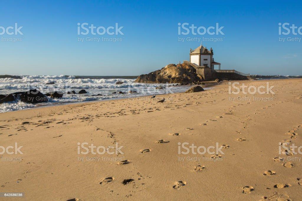 Chapel Senhor da Pedra at Miramar Beach, Portugal. stock photo