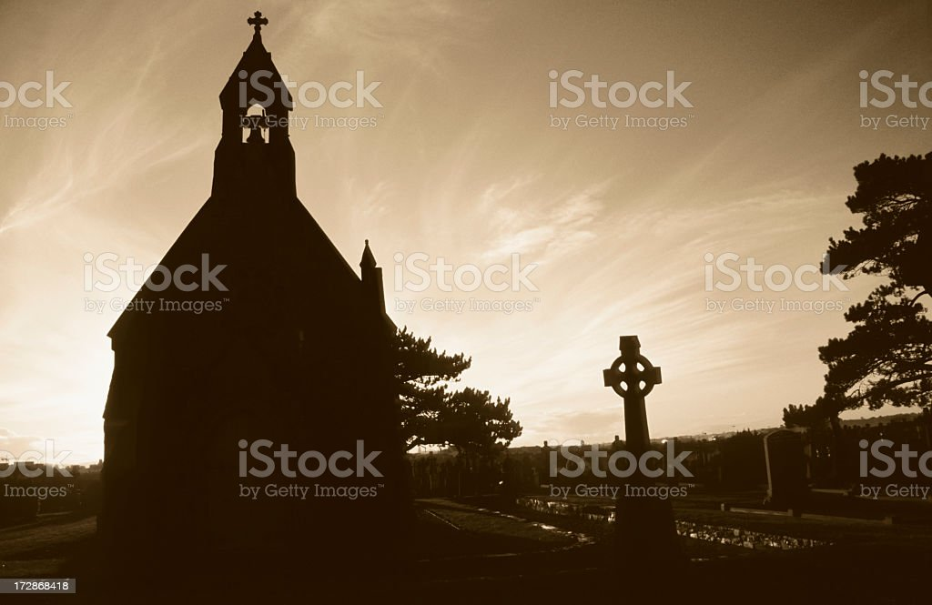 chapel silhouette in front of the setting sun stock photo