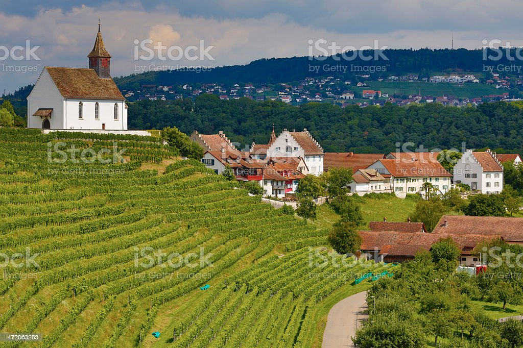 Chapel, vineyard and village stock photo