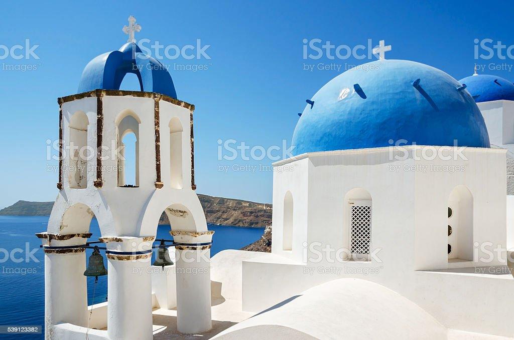 Chapel with blue dome - Oia, Santorini Island in Greece stock photo