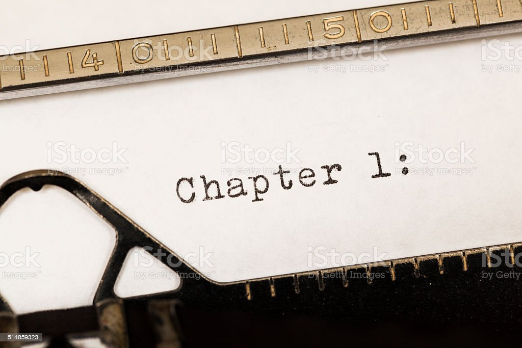 Chapter 1 written on old typewriter. stock photo