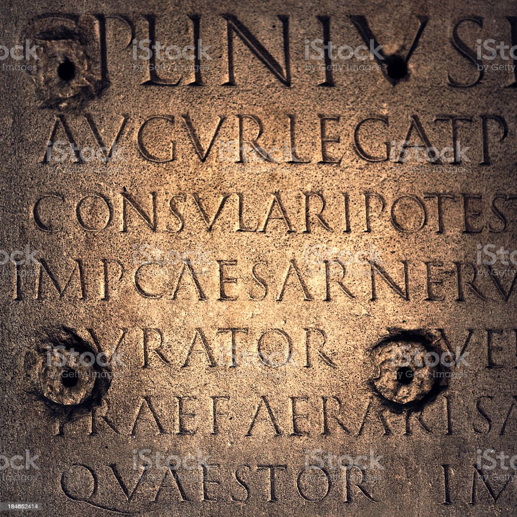 characters in latin on a church wall royalty-free stock photo