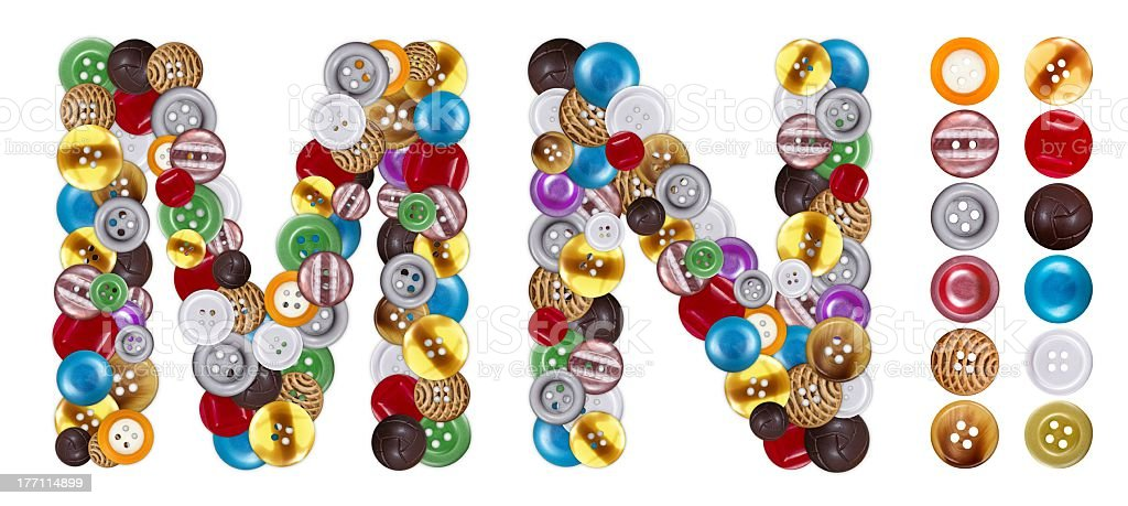 Characters M and N made of clothing buttons royalty-free stock photo