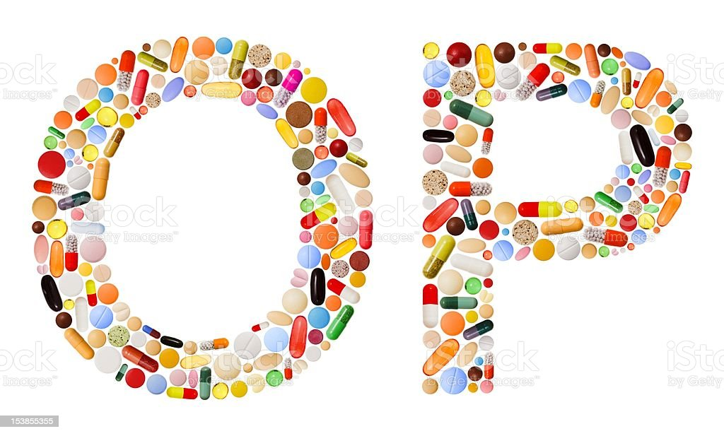 Characters O and P made of colorful pills royalty-free stock photo