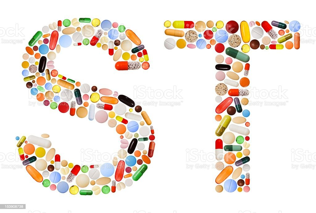 Characters S and T made of colorful pills stock photo