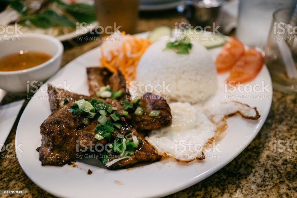 Charbroiled Pork with Egg on Rice stock photo
