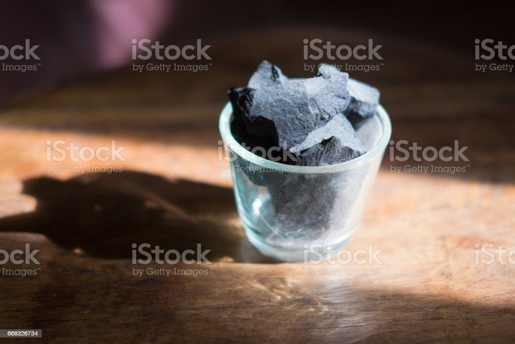 Charcoal arranged in a glass vase. Acts deodorizer which increase negative ions and purifies air stock photo