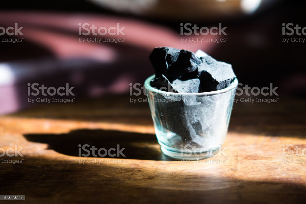 Charcoal arranged in a glass vase stock photo