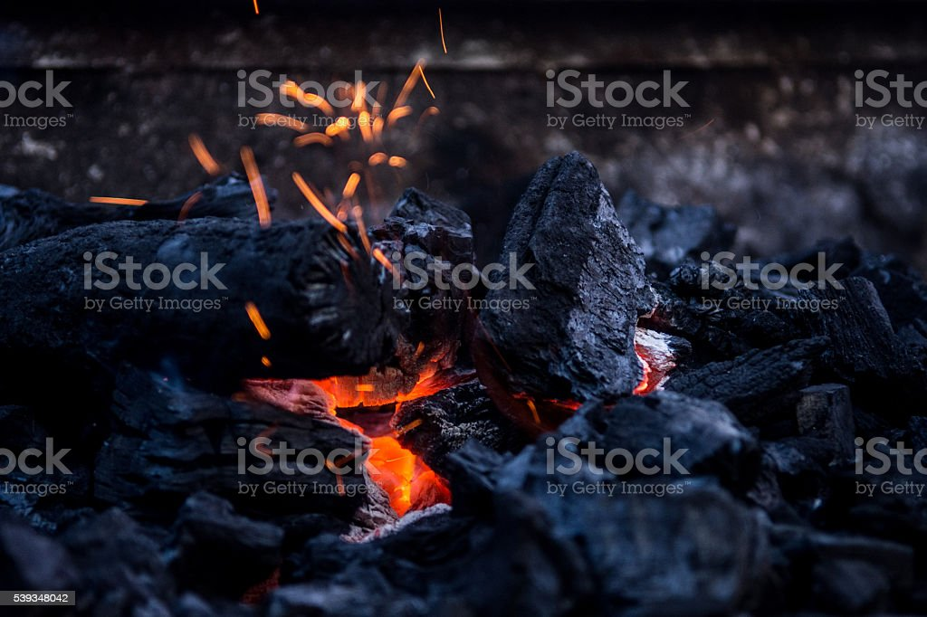 Charcoal burning stock photo