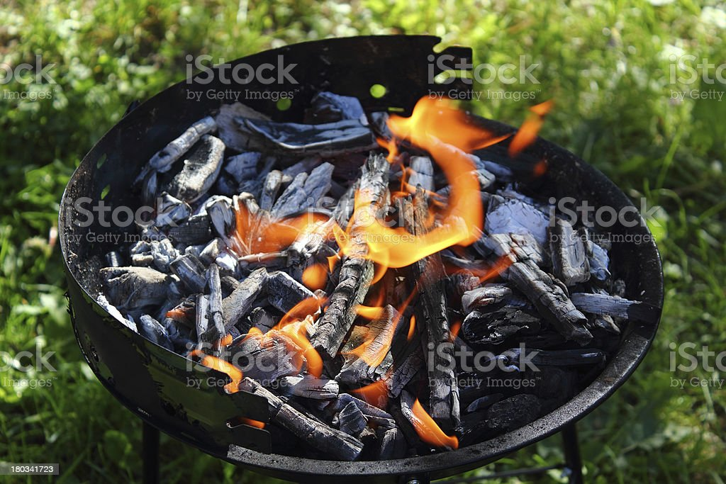 Charcoal fire in barbecue grill royalty-free stock photo